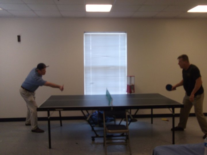Priest Scott playing ping pong