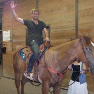 Tom Bourlet riding a horse