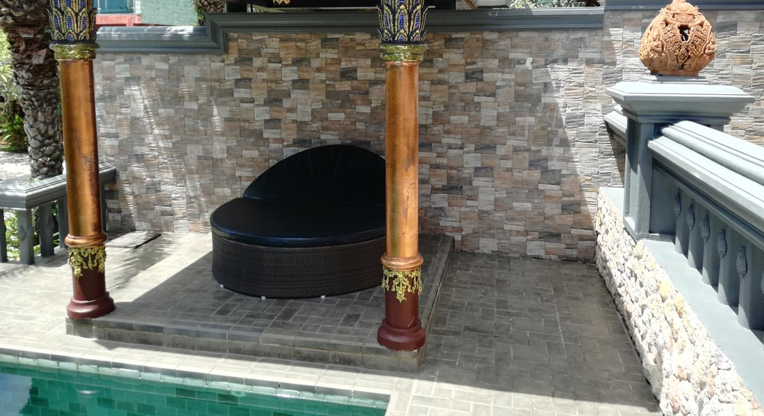 sofa next to pool